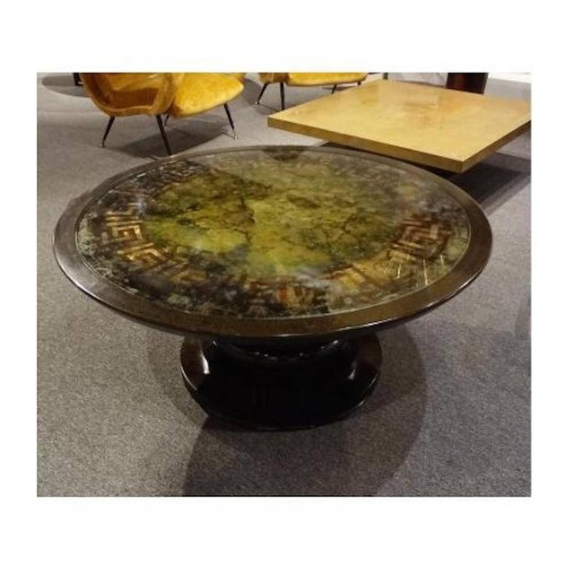 Round Cocktail Table with a Reverse Painted Glass Top, France circa 1970's For Sale - Image 4 of 5