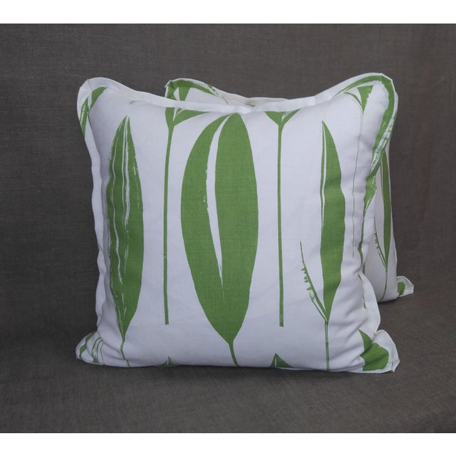 Pair of Raoul Textiles throw pillows in Variegata Linen Print, Lawn colorway, flat welt with pinched corner and zipper, a...