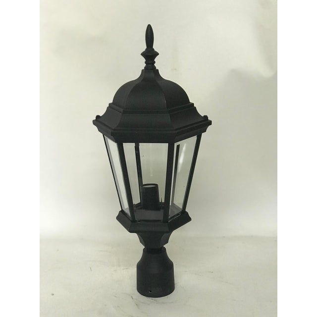 This is a pair of elegant aluminum post lanterns for entranceway pillars. The pieces offer a colonial style and UL...