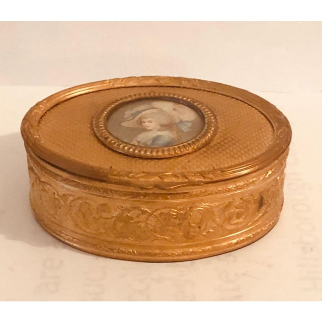 A strikingly beautiful French dore bronze box is all engraved with an ivory picture of an aristocrat, LeBron. The box is...