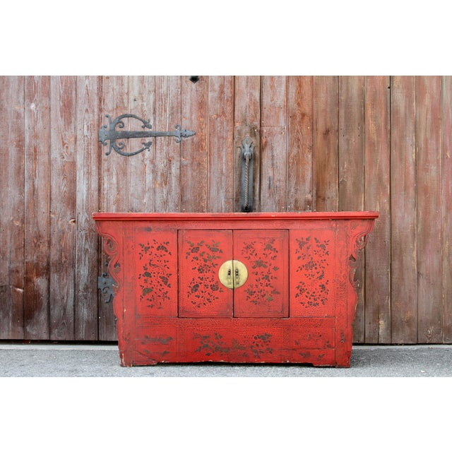 Radiant Chinese cabinet with original red gilt painted front that showcases classic gold Chinoserie handles with beautiful...