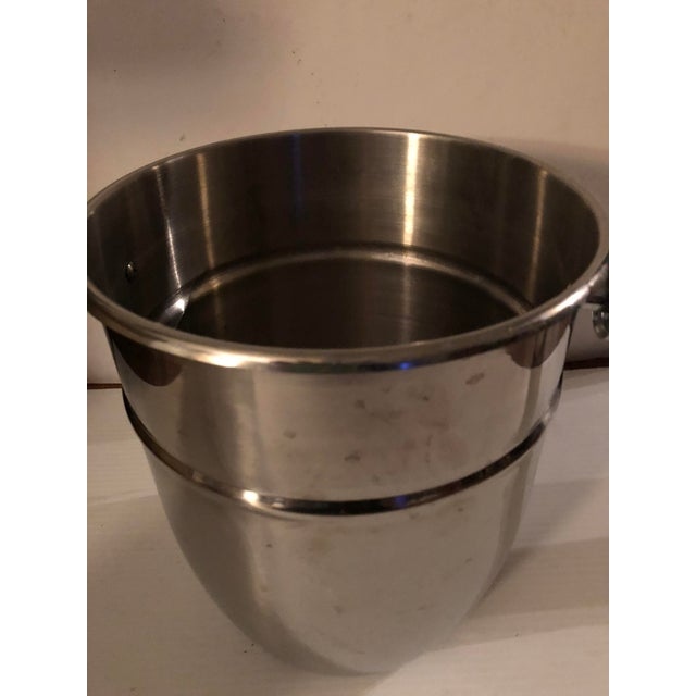 Vintage stainless steel chrome champagne ice bucket. Great as a ice bucket keeps ice solid for a evening. Nice sleek...