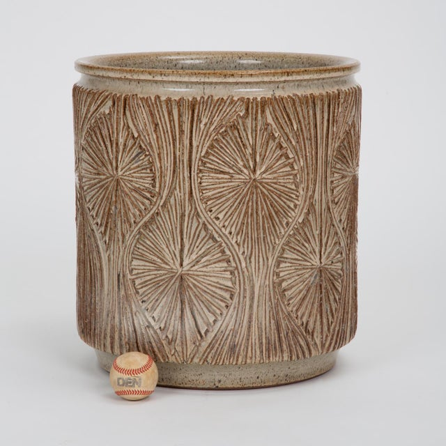 A cylindrical planter from Earthgender, David Cressey and Robert Maxwell's early 1970s project. This example is incised in...