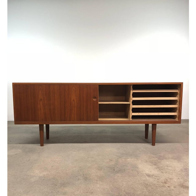 Credenza/sideboard model 26, in Teak, oak and brass, designed by Hans J. Wegner and produced in Denmark by Ry Møbler,...