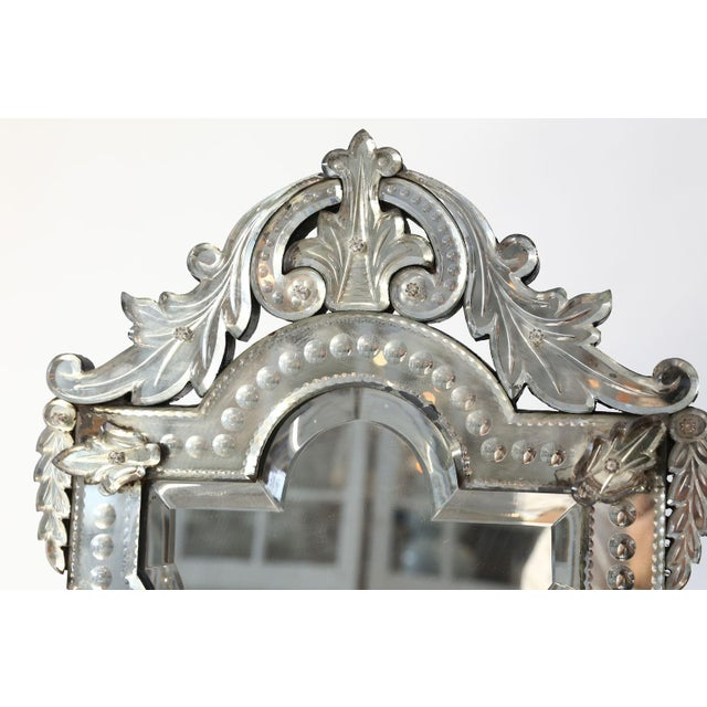 Vanity-top Venetian mirror dating from the late 19th century. Beautiful openwork crest and embellishments. Can sit upon a...