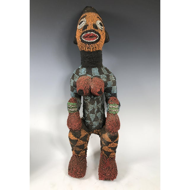 African art, tribal art Bamileke Beaded Statue from Cameroon. Made of wood and beads. Very good and excellent condition.