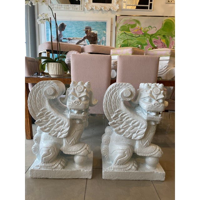 Vintage pair of plaster foo dogs in a very light blue lacquer. These are very heavy and can support a large piece of glass...