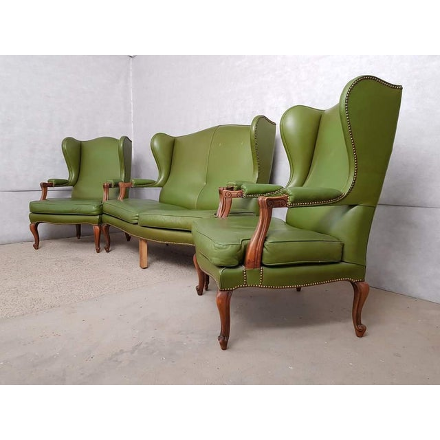 Gorgeous leather 3 piece suite comprising a pair of Queen Anne style wing back armchairs and a 'Club Settee' two seater...