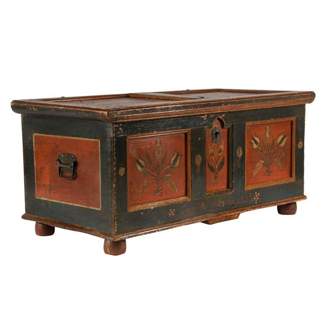 This 1860's Scandinavian truck is made of pine wood and features the original polychrome painted details. The carved wood...