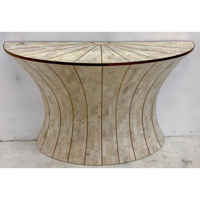 This is a good looking tassellated console table with mirror by Maitland-Smith. It has a great look and is in excellent...