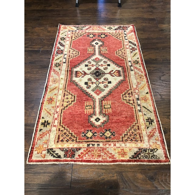 A beautiful vintage Turkish rug. It has a unique pattern and incorporates dark salmon with eggshell white. It would make a...