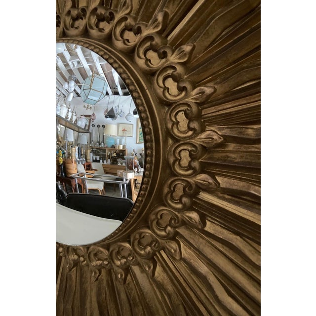 Iconic vintage gilded syrocowood convex wall mirror. Made in the 1960s.