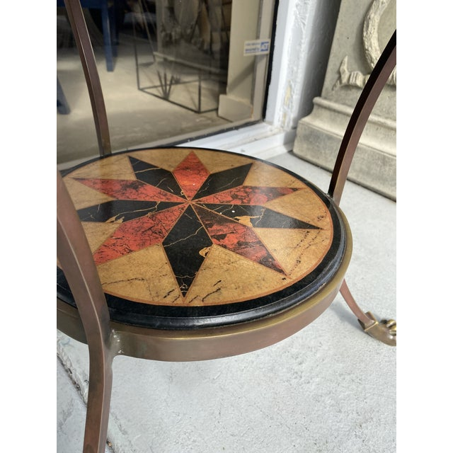 Round gueridon table whith faux marble sea star design top in bronze perfect for any house entrance.