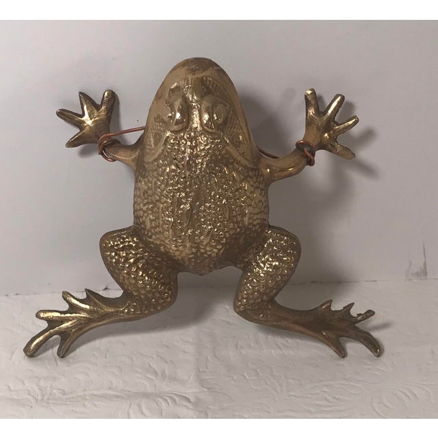 Vintage brass frog figurine can be used on a desk or shelf or hung on the wall.