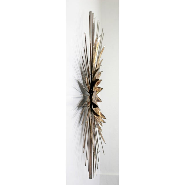 For your consideration is a brilliant, brass wall sculpture of a large flower, in the style of Curtis Jere, circa 1970s....