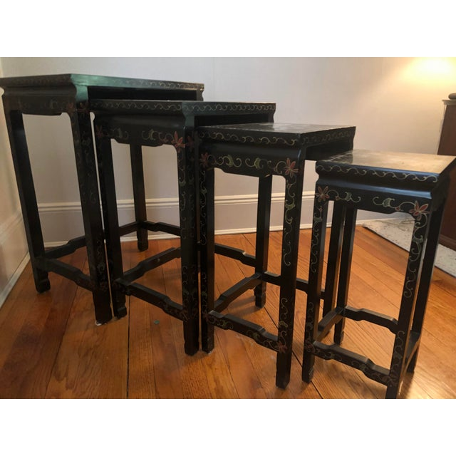 Set of four antique Chinoiserie painted Asian lacquerware nesting tables with mother of pearl inlay and hand painted...