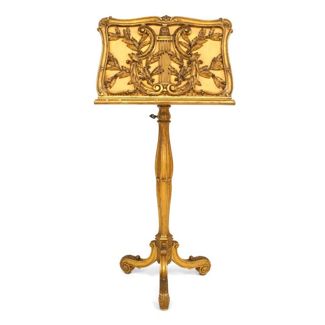 French Louis XV style (19th century) gilt carved adjustable pedestal base double sided (duet) music stand with lyre design.