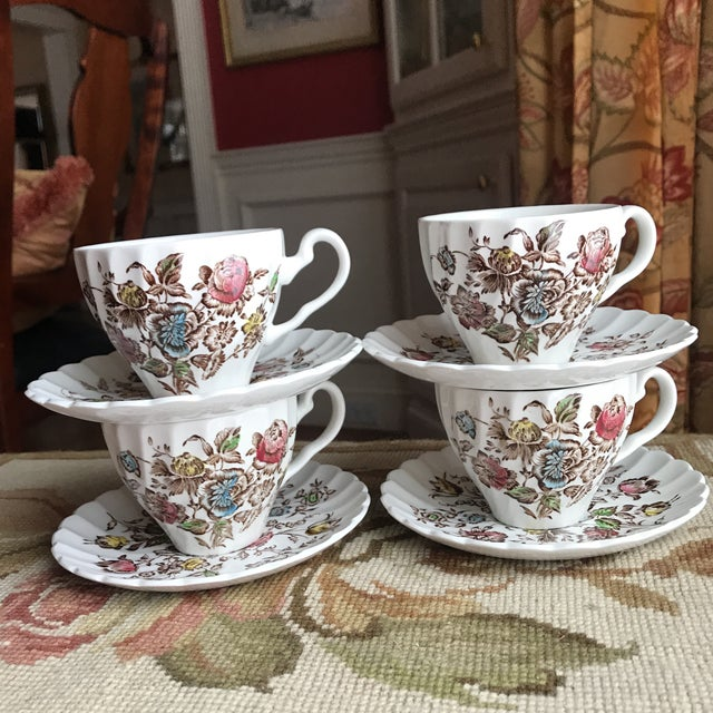 4 cups & saucers and 3 piece cream & sugar set... a lovely vintage collection, whether for coffee or tea.