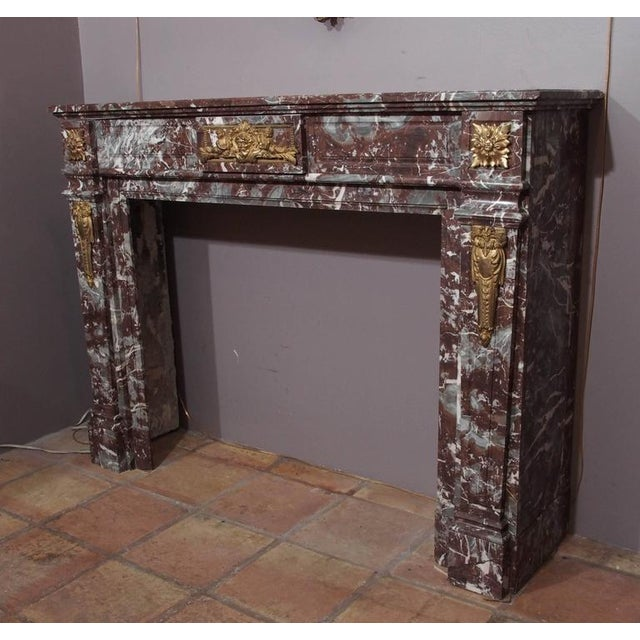 Fine antique French bronze mounted marble mantel. Louis XVI style. Bacchus mask.