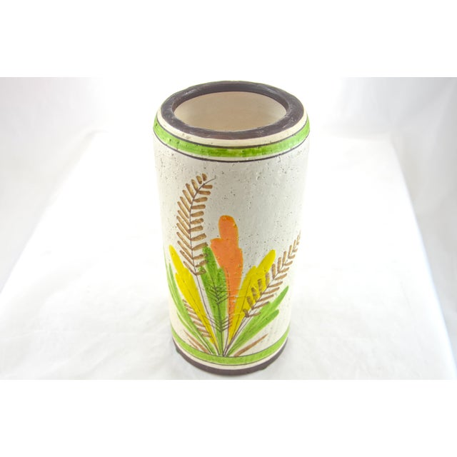 Mid-Century Italian hand-decorated ceramic vase with a vivid lime green, yellow, goldenrod and orange floral design...