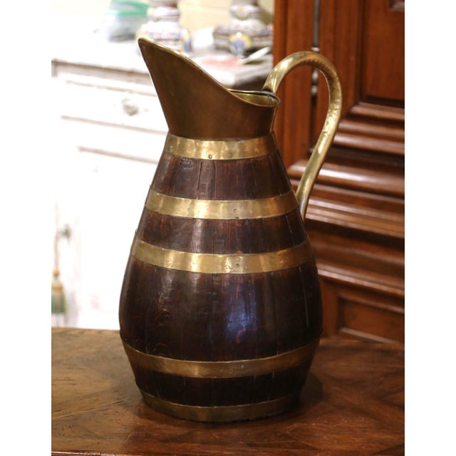 Accessorize your wine cellar or wet bar with this antique cider pitcher jug; crafted in Normandy France circa 1870, the...
