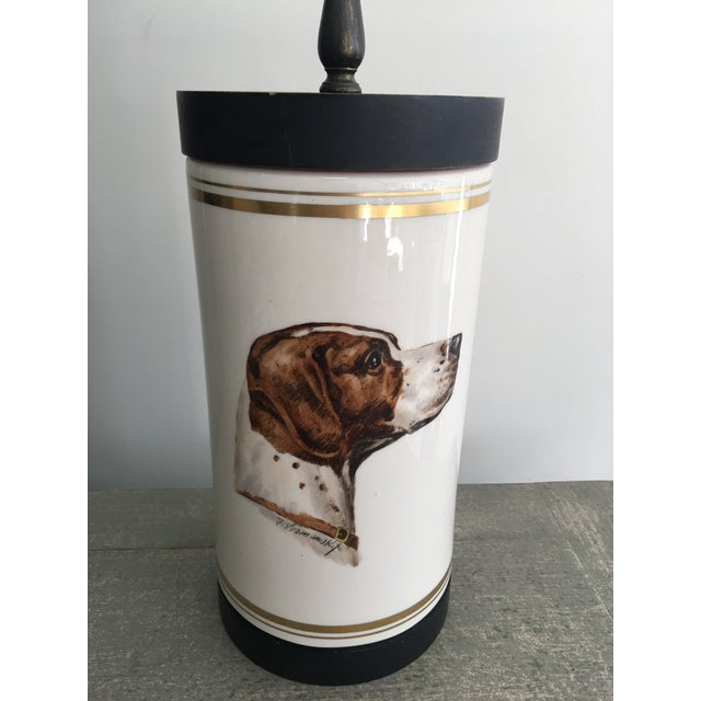 Vintage mid-century ceramic table lamp, mounted on wood and hand painted with Pointer dog and trimmed in gold. This...