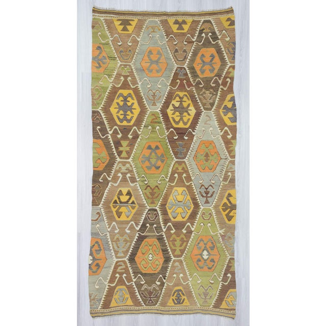 This is a handwoven vintage decorative Turkish kilim rug from the Antalya region of Turkey. It is in very good condition...