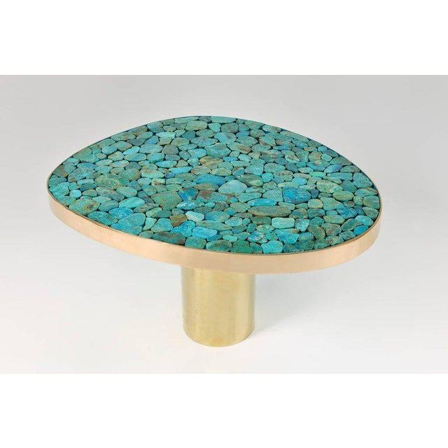 Very refined coffee table by Kam Tin. The base is in brass and the top is composed of a turquoise mosaic. The edge is in...