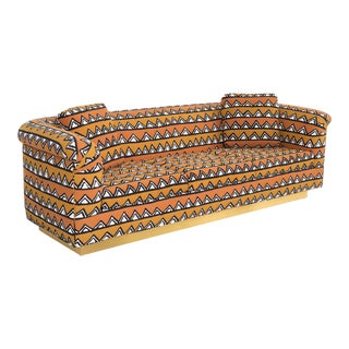 Rounded Barrel Back Brass Platform Sofa Reupholstered in African Mud Cloth For Sale