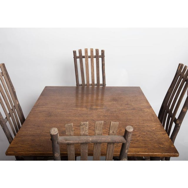 Antique Adirondack old hickory table with oak top and chairs.
