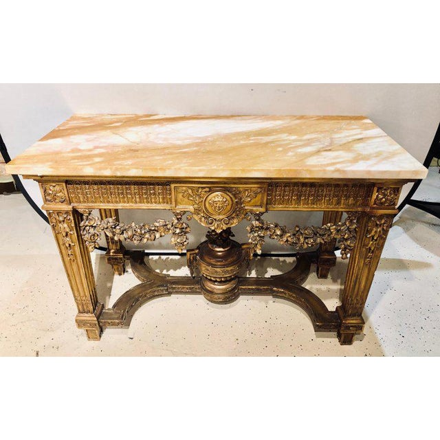 A fine turn of the century Louis XV style giltwood marble-top console table with urn form undercarriage. This fine...