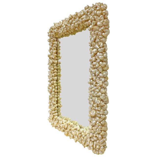 A fantastic half-length mirror wearing a frame fully encrusted with seashells. An otherwise straightforward, utilitarian...