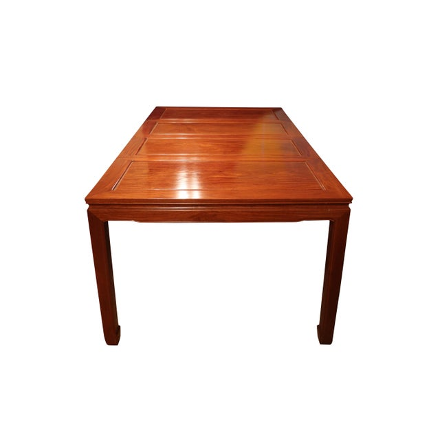 High quality Chinese Ming style rosewood dining table with 8 matching chairs made in the 1980's in Southern China. Simple...