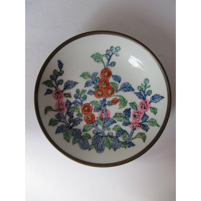Beautiful vintage porcelain chinoiserie plate with colorful flowers, encased in brass. Combined shipping available.