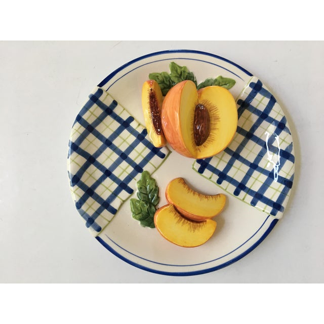 Offering a lovely decorative, Trompe l'Oeil painted blue and white plaid plate. This dimensional plate is adorned with a...