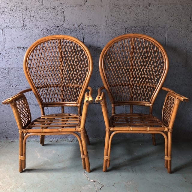 Fabulous side chairs made from rattan and bamboo in the style of the fan or peacock chair.The pair of chairs is very...
