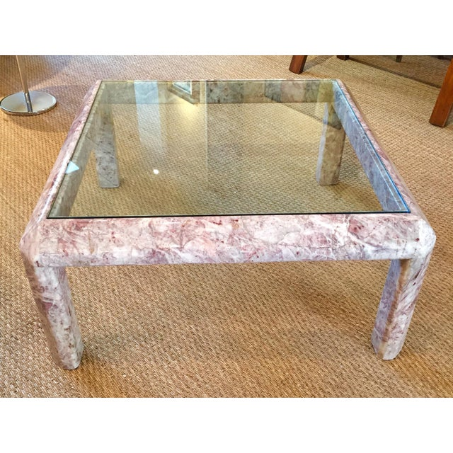 Elegant and simple Mid Century marble and glass coffee or cocktail table. Heavy figured marble base in unusual palette of...