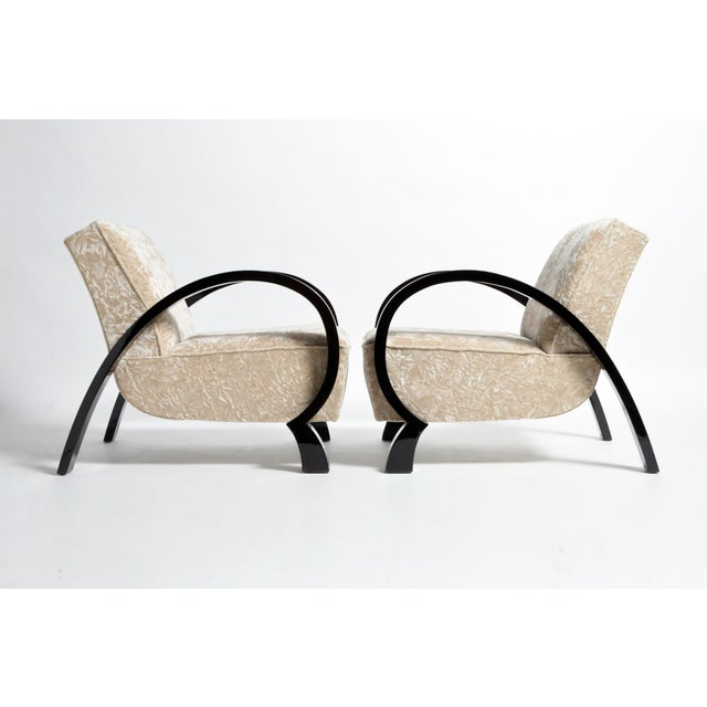 This pair of armchairs are from Hungary and made from solid walnut and upholstery, circa 1960. The chairs are comfortable...
