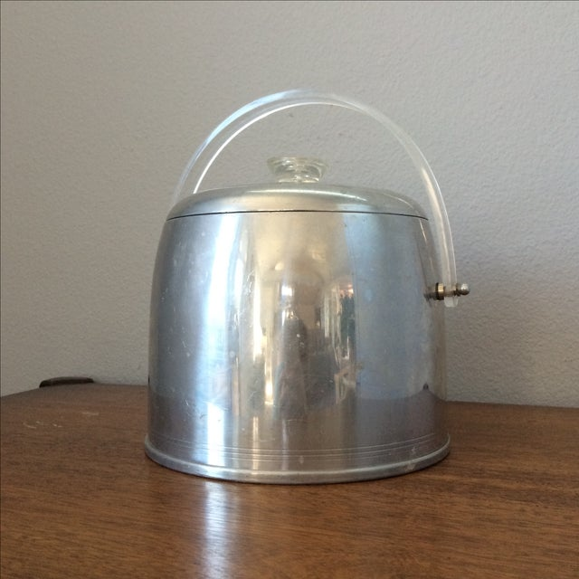 Offered is a vintage Kromex ice bucket with lucite handle and top knob. Perfect addition to any bar or cocktail party!...