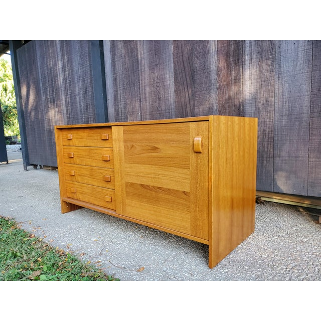 Beautiful credenza by Domino Mobler, some light wear and nicks on the top as seen in photos and veneer chips out of the...