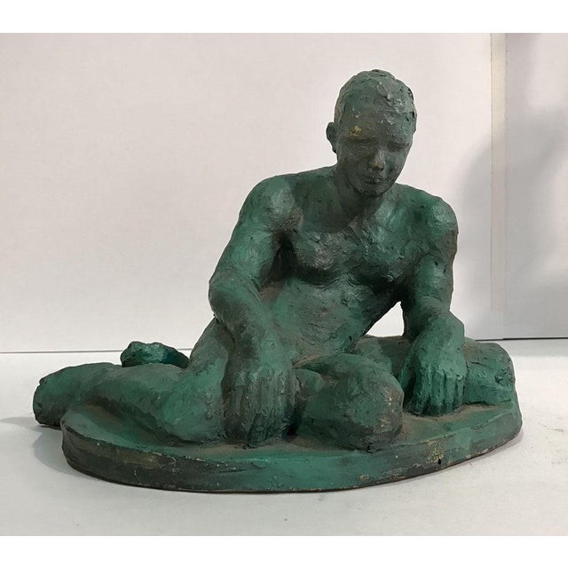 Striking and stylish sculpture of a reclining nude male. Beautifully rendered and exquisitely detailed. Signed in...