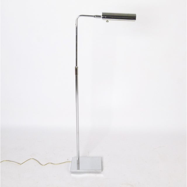 USA, 1970s Chrome floor lamp adjusts in height and tilts to desired position. Hand switch conveniently within reach....