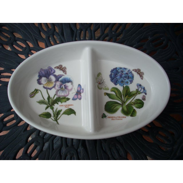 Pansy and blue primrose divided bowl; outside is decorated with a mauve flower and butterfly motif.