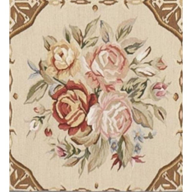 This is a new Tapestry. Various floral bouquets within organized panels surrounded by floral decorated border.