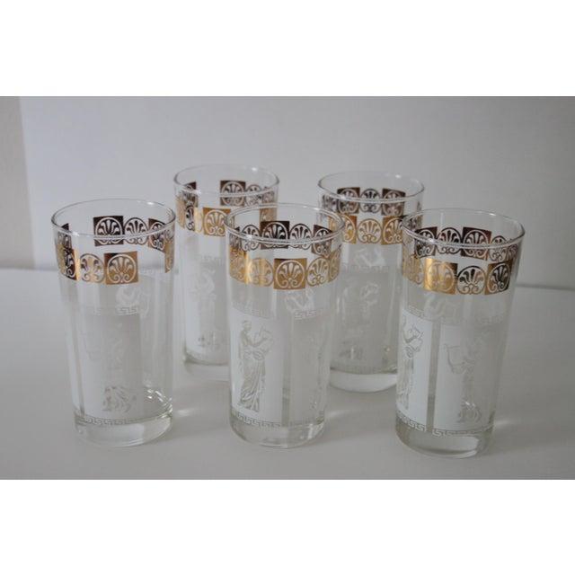 Vintage set of five Greek glasses. Glasses have images of ancient Greeks with instruments.