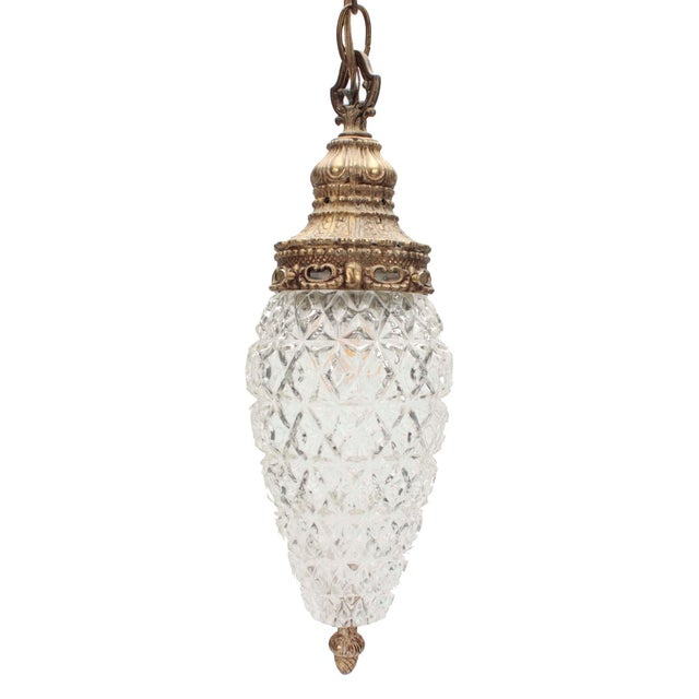 Circa late 1960s or early 70s, this antique gold colored double-swag pendant light fixture has great patina, can be...