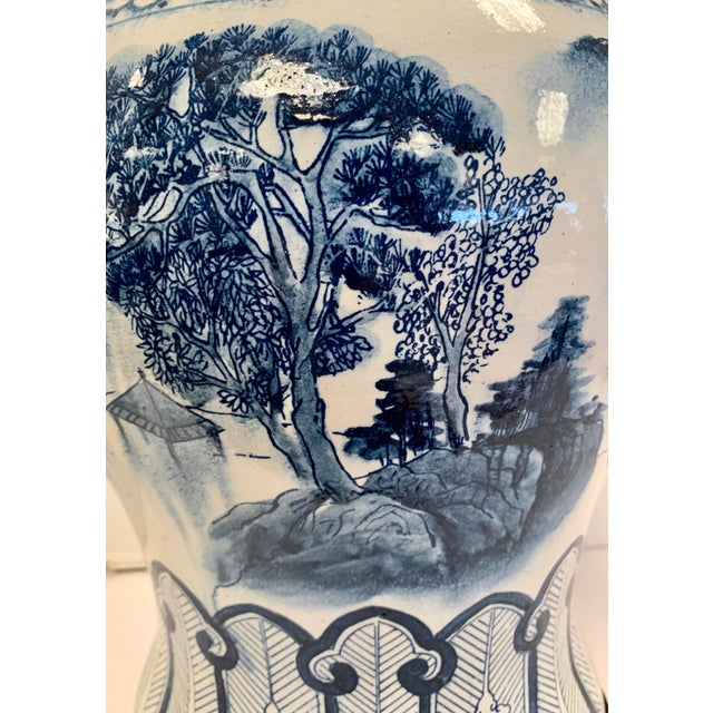 Beautiful large chinoiserie blue and white porcelain lamp by Chapman hand painted with landscape scenery. Topped with a...