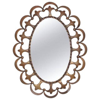 Hollywood Regency Antique Oval Mirror With Sculptural Brass Frame For Sale
