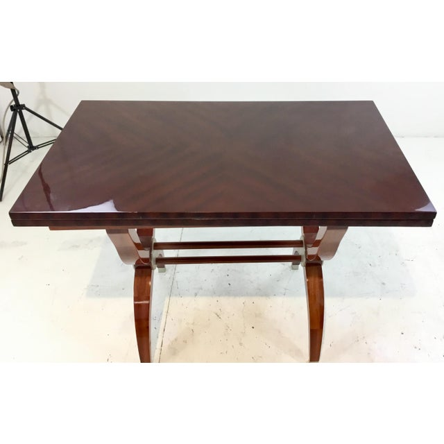 Stylish Global Views convert a table ribbon mahogany console table/dining table, silver metal ferrules, expands to 47W x...