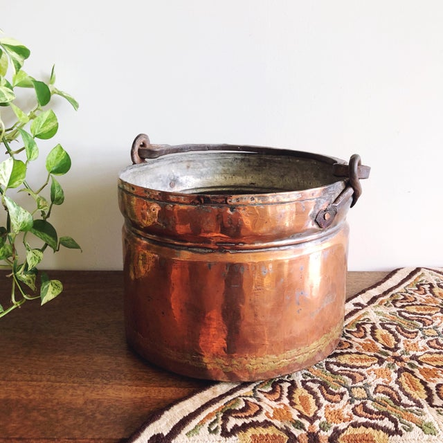 Antique 1800s large primitive rustic hand forged French copper cauldron with textured iron handle. A beautiful 19th...